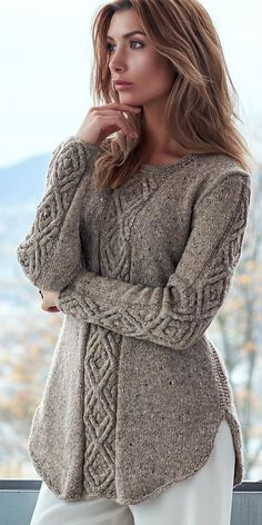 Knitting Pattern for Oydis Sweater - A shadow diamond cable dominates this A-lin. Knitting Pattern for Oydis Sweater - A shadow diamond cable dominates this A-line sweater with a curved flattering hem, . Aran Knitting Patterns, Cable Knitting, Knitting Stitches, Knitting Designs, Knit Patterns, Vogue Knitting, Knitting Tutorials, Free Knitting, Stitch Patterns