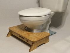 The most compact and discreet Poop Stoop, this low platform style model gives a gentle lift to help you poop better (or to deal with the fact that your feet dangle because your toilet feels like it wa Bath Stool, Diy Stool, Wooden Projects, Wood Crafts, Potty Stool, Toilet Step, Squatty Potty, Easy Woodworking Ideas, Bathroom Gadgets