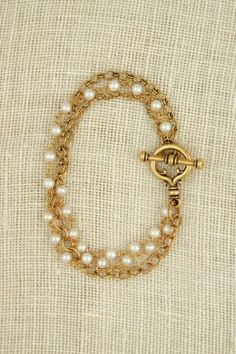 Graham bracelet in gold with freshwater pearls  www.exvotovintage.com