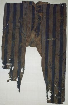 Trousers, possibly 12th–14th century.  No info about where these might harken from, however the fabric matches another fragment from Morocco.  Perhaps these either came from there or were made in an area trading for Moroccan fabric?