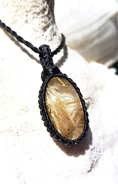 Rutilated Quartz macramé necklace. This is a quality rutilated quartz - crystal clear and filled with gorgeous golden threads. Besides being
