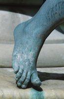No, it's not an green alien's foot, it's just an oxidixed metal statue with a nice patina.
