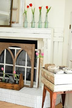 Give your fireplace a springtime facelift by placing repurposed windows over your unused hearth