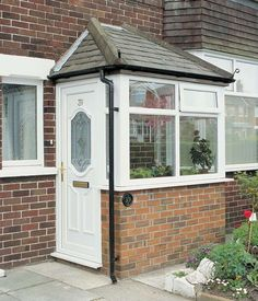 Looking to get front door porch prices? A garden porch enables an amazing and also welcoming space during the warm weather – and even into wintertime… Porch Uk, Front Door Porch, Porch Doors, Front Porch Design, Garage Door Design, Side Porch, House With Porch, House Front, Garage Doors