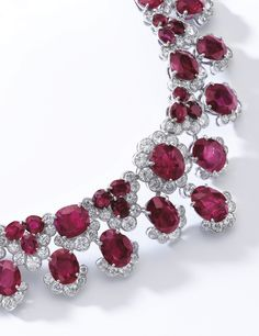 RUBY AND DIAMOND NECKLACE, BULGARI, CIRCA 1960 Designed as a graduated fringe of oval and cushion-shaped rubies, highlighted with brilliant-cut diamonds, length approximately 370mm, signed Bulgari, fitted case by Bulgari.