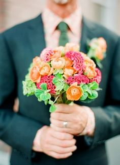 Wedding bouquet of Pink, orange, and green using celosia, ranunculus, and hydrangea.