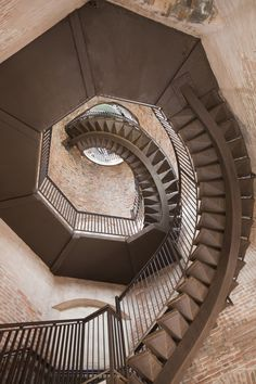 From the Lamberti tower in Verona, Italy.  32  Staircases That Will Give You Instant Vertigo