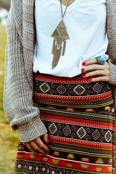 I love how versatile a white tee can be. The sweater makes it fall appropriate and the Aztec print skirt gives it an edgy vibe for the season.