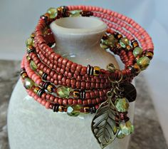 Shades of Coral and Green Layered Memory Wire Cuff Bracelet. Stacks of Seed Beads and Crystals. Charms.