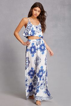 A woven floral paisley print two-piece set featuring a crop top with dual adjustable Y-back straps, a keyhole button back closure, a flounce layered scoop neck, and a smock waist, along with a pair of matching palazzo pants with split leg slits, and a partially smocked waist.<p>- This is an independent brand and not a Forever 21 branded item.</p>