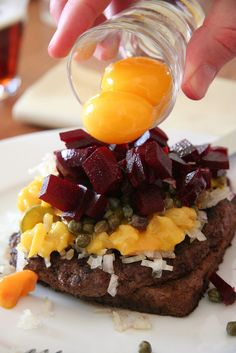 A traditional type of #Danish #smørrebrød with steak, onions, capers, beetroot and raw eggs! #delicious
