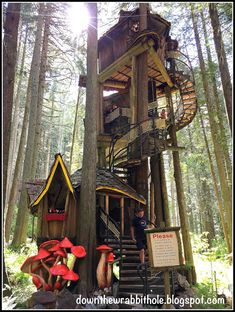 """Climb to the top of the three story treehouse at the Enchanted Forest in British Columbia, Canada. Find out more at """"Down the Wrabbit Hole - The Travel Bucket List"""". Click the image for the blog post."""