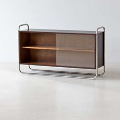 Anonymous; Chromed Metal, Wood and Glass Cabinet, 1930s.