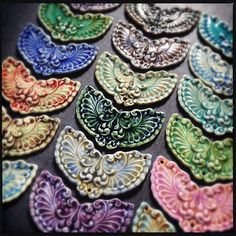 Ornate porcelain pendants.