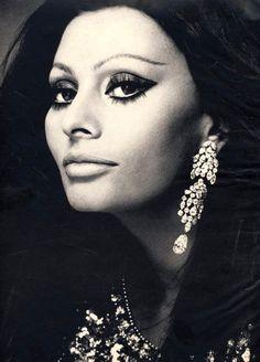 Sophia Loren models Cartier earrings, Harper's Bazaar, December, 1970, photo by Von Wangenheim