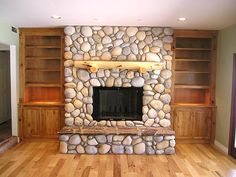 River rock fireplace, knotty alder built ins!!