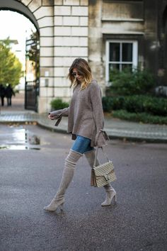 Emma Hill wears taupe sweater with tie sleeves, skinny jeans, grey Stuart Weitzman otk thigh high highland boots, Gucci Dionysus bag, chic autumn fall outfit