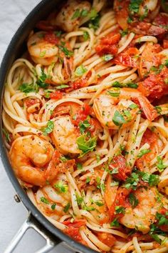 A simple spicy shrimp pasta that's perfect for the summertime! Similar to the shrimp fra diavolo you get at Italian restaurants, this recipe is made with lots of garlic and cherry tomatoes bursting wi