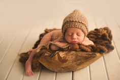 Newborn in a wood bowl Devoted Knit stuffer and bonnet  www.facebook.com/rachelvanovenphotography Rachel Vanoven Photography