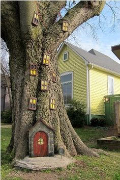 Try using doll house accessories to make a fairy tree- This one looks a bit over done to me but it is all in the eye of the beholder. Be careful when attaching to the tree and don't cause too much bark damage or you will get rot-not good for a tree.