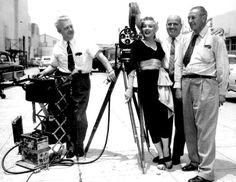 """Marilyn Monroe receiving an award for the time she spent in Korea, 1954. """