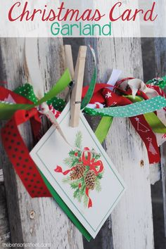 Ready to use up ribbon scraps and have a fun way to display Christmas cards? Make an easy but adorable Christmas Card Garland at thebensonstreet.com #christmascards #christmascardisplays #christmasgarland #christmasdecorations #christmasribbon #ribboncrafts #christmasdecor #christmas