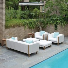 Outdoor wicker sofa set with natural teak accents. Available in 20+ wicker colors and 250+ cushion fabrics.