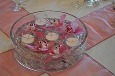 Cylinder Bowl with Cymbidium Orchid Blooms and Votives: <span>Low cylinder bowl with crystal gems provide added sparkle when the candles are lit.  Floating cymbidium orchid blooms add a touch of elegance.</span>