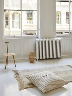 Floor pillows, shaggy rugs, candles, tea towels, and more — introducing the new in-house line by The Primary Essentials.