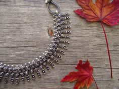 Tribal Metal Necklace Banjara Jewelry Metal by LaMirraFashion This metal necklace has intricate leaf motif adorning the chain. The chain itself has pretty design that you will love. The necklace is light weight and looks great for casual and party wear.