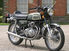 There is something beautiful about the straightforward design of this older Honda cb350.
