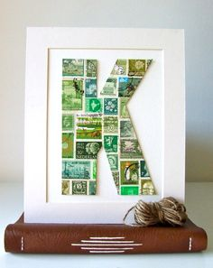 """damian is anti-letter art, but i love this """"K"""" made out of stamps."""