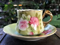 """Lefton Heritage DEMITASSE Tea Cup - Teacup and Saucer Made in Japan. Highly collectible Heritage green set with fancy gilt handles and wavy rims. This set is adorable! Cup: 2.2"""" high and 3"""" wide out to handle. Saucer is 4.75"""" wide No chips, cracks or crazing. No wear to the cups gold gilt! Backstamp: Lefton China Hand Painted."""