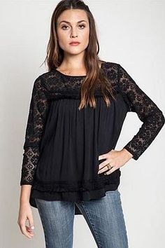 Gauze and lace top with lace sleeves and neckline. Lace pattern stripe on bottom of garment. Back button closure top.  60% Cotton / 40% Polyester  Dry Clean Only / Hang To Dry