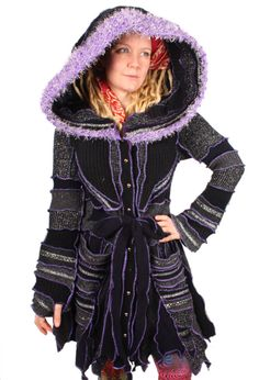 This supersonic coat will astral-project you to the outer reaches of fabulousness. Its rich charcoal hues are brought to life with vibrant purple seams and a lightning storm of vintage metallic silver trim. It also features a hand-knit purple sparkle fringe on the hood and a galaxy of little silver buttons. Bust: 44 Length: 45  Size: XL  For reference the model is 510 size 12, 36D.  Enjoy! ***  I make lots of funky, reconstructed sweaters out of recycled materials. I am forever combing…