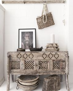 This is the 'rustic' corner of the store. We have a collection of beautiful old pieces with raw/bleached finishes. The stunning image of the holy man is by Gerry Pacher. Image by @villastyling #rustichomewares #rusticdecor #nomad #damchiya #rawtimber #indianfurniture #lifestylestore #noosa #globaldecor