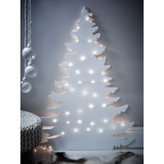 Carefully crafted from lightweight wood, our large tree silhouette is perfect for those who prefer a more contemporary Christmas. Whether displayed on its own or teamed with our 10 metre Naked Wire Lights¸ this simple white tree makes a striking alternative or addition to traditional trees.   Click here to explore our White Christmas collection and create this look.