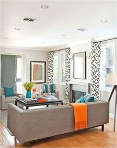 In love with this orange, grey and turquoise living room!
