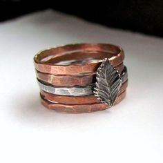 A walk in the woods - hammered cooper bands with oxidized sterling leaf ring stack