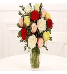 No other flowers express feelings of romantic love as perfectly as beautiful red roses. This simple and stylish hand-tied bouquet of red roses is finished with classic ruscus foliage and will send your message of love and admiration with every velvety red petal of every single rose.