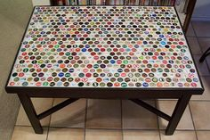 """Beer bottle cap table for rec room/patio. On the """"to do"""" list of projects. Beer Cap Art, Beer Bottle Caps, Bottle Cap Art, Beer Caps, Beer Pong, Bottle Top Crafts, Bottle Cap Projects, Bottle Top Tables, Beer Cap Table"""