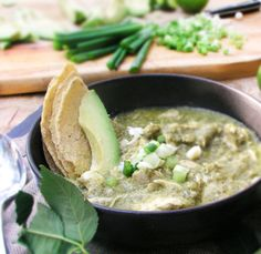 Guatemalan Green Chicken Stew -Tender white meat chicken simmered in a tangy tomatillo and cilantro sauce