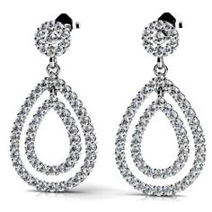 Whether you're stepping out for a meeting or for a stylish evening out, always choose class and elegance--sparkle in the gorgeous Diamond Link Earrings in White Gold. http://www.brilliance.com/earrings/diamond-link-earrings-white-gold