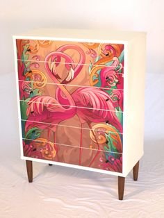 Totally unique and one of a kind upcycled vintage child's tallboy/dresser/chest of drawers