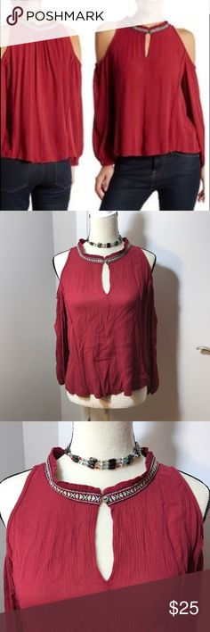 Melrose and Market Cold Shoulder Red Dharma Top New with tags. No damages, stains, or wearing. This lovely dark red cold shoulder shirt features a brighter trim collar buttons over a keyhole front. The sleeves are gathered at the wrist. The seams feature a deliberate rough cut edge, not actually sewn inside out! The style is meant to drape a little, the hem line is quite wide. Measurements in picture. Sku:bx4-13 Melrose and Market Tops