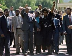 In an iconic photo dating back to Feb. 11, 1990, Nelson Mandela and his wife Winnie raise their fists in the air as they salute cheering crowds following Mandela's release from the Victor Verster prison. The anti-apartheid icon spent 27 years in jail before being released.