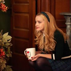 (Open with Cairo) Cairo sat in the awkward official uniform in the hall, sipping a hot beverage and studying a picture intensely.