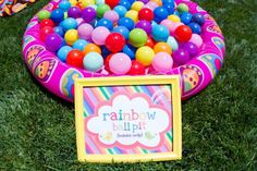 Rainbow baby ball pit at a 1st birthday party- total hit with the birthday girl...