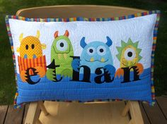 Personalized applique pillow with monsters