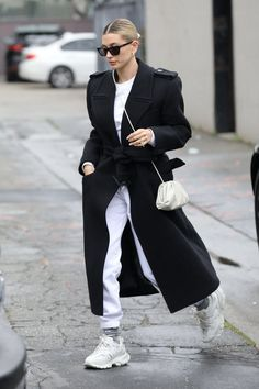 Making moves: Hailey donned a long black robe coat over white sweats and white Balenciaga . Look Street Style, Model Street Style, Street Chic, Street Styles, Models Style, Sport Chic, Style Invierno, Mode Outfits, Fashion Outfits